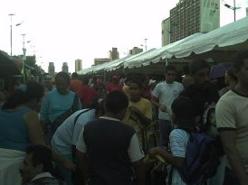 Lines to get subsidized pork at Mega Mercal market in downtown Caracas (2007)