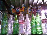 Yare Devils' masks and old recycled bottles at la Gran Pulperia shop in western Caracas (2008)