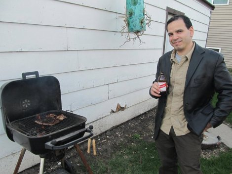 Hector watching over the steak during my graduation party in 2011. We already had bellies full of beer, chorizos and chicken by then. Como Dios manda.